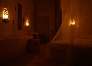 The beauty and efficiency of long-forgotten simple candles illuminating guest rooms at night. Feynan Eco Lodge, Jordan
