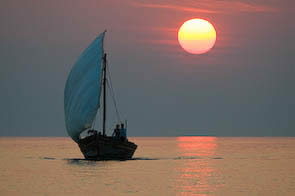 Pumulani Luxe Lodge on Lake Malawi 13-Dhow Sailing against Sunset
